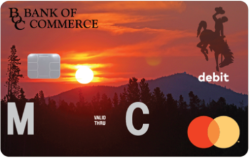 Picture of MasterCard Debit card with sun setting in background.